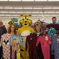 Steve Quinn of JD Swallow helps pick out warm pjs for Ottawa children